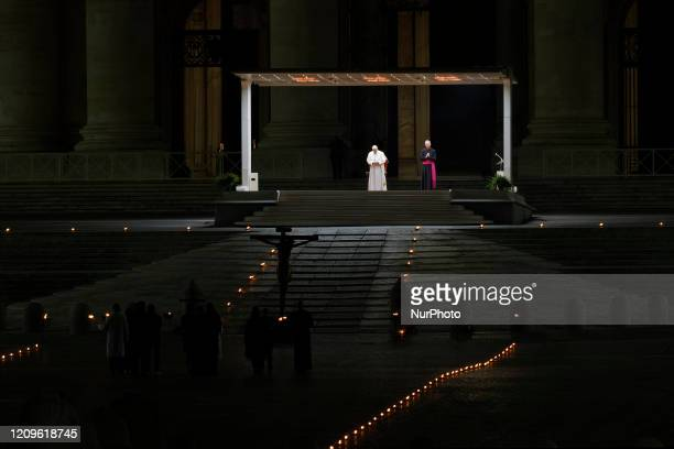 Pope Francis leads the Via Crucis or Way of the Cross ceremony in front of St. Peter's Basilica, empty of the faithful following Italy's ban on...