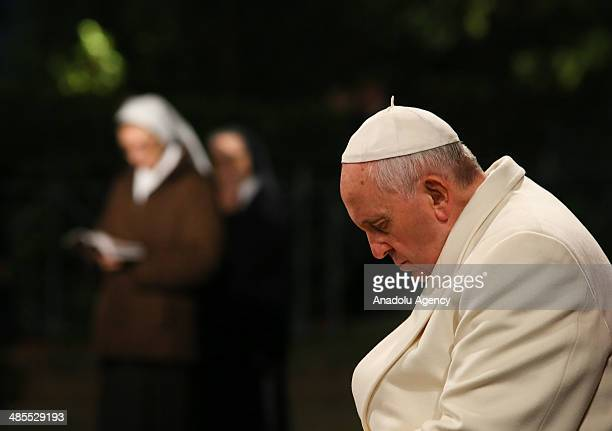 Pope Francis leads the Way of the Cross at the Good Friday service before Easter holiday at Colosseum in Rome Italy on April 18 2014
