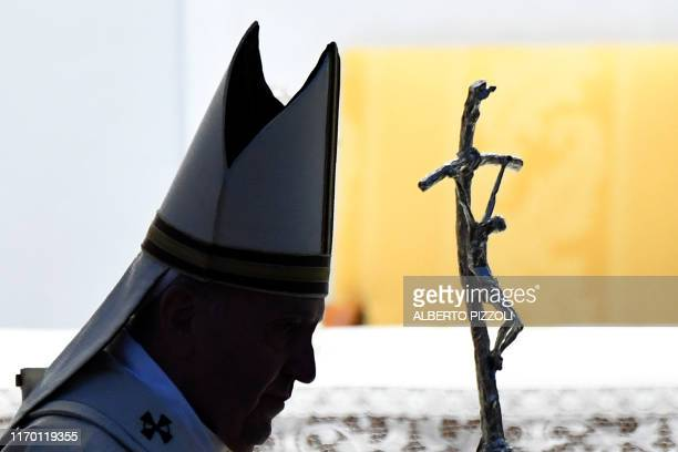 TOPSHOT Pope Francis leaves after celebrating the Holy Eucharist on September 21 2019 during a visit to the cathedral of Albano Laziale southeast of...