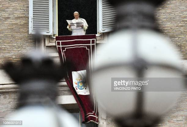 Pope Francis leaves after he blessed pilgrims gathered in St Peter's Square at The Vatican on November 1 following his Angelus prayer to mark the All...