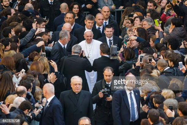 Pope Francis leaves at the end of his visits at the Roma Tre University one of Rome's three state run universities in Rome Italy Pope Francis...