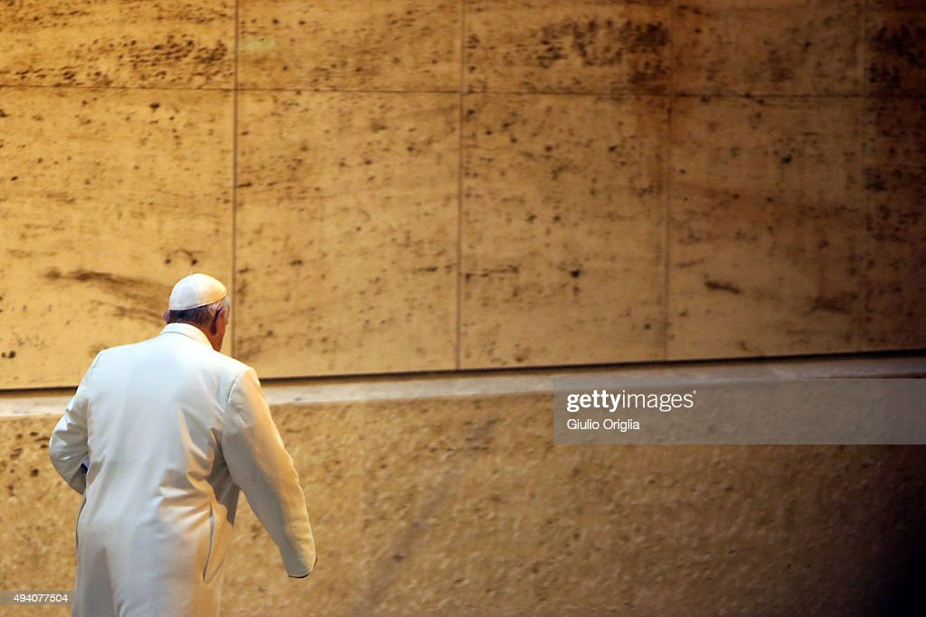 Pope Francis leaves the closing session of the Synod on the themes of family the at Synod Hall on October 24, 2015 in Vatican City, Vatican. The final document has been welcomed by most as a carefully crafted work of art which seeks to balance the very different views and cultural perspectives of all Synod participants.