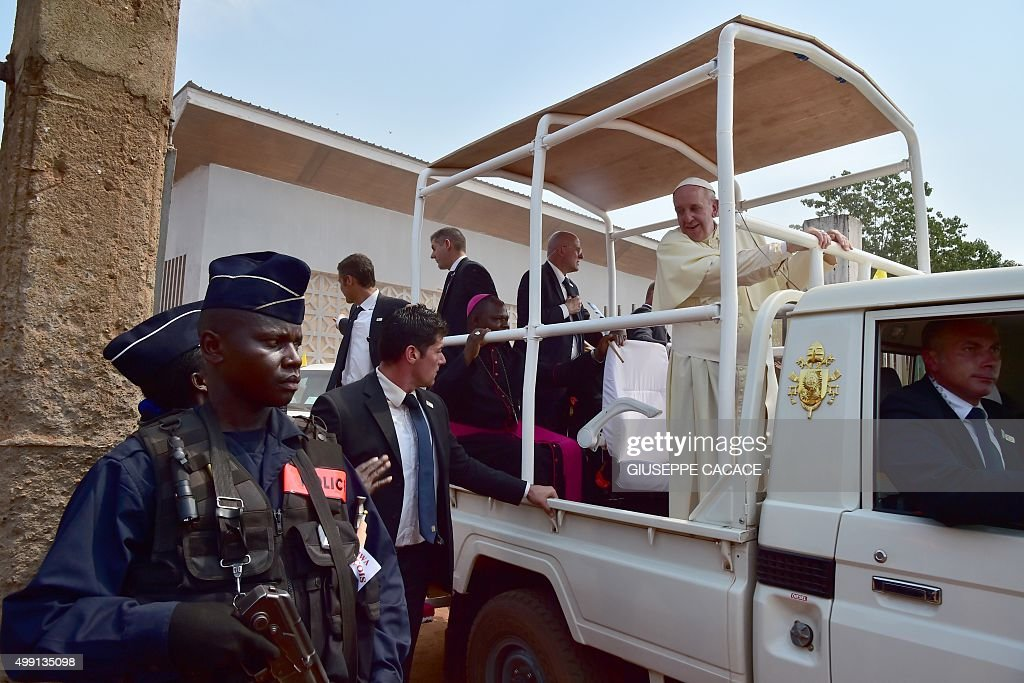 Pope Francis leaves the refugee camp in Bangui on November 29, 2015. Pope Francis arrived as 'a pilgrim of peace' in conflict-ridden Central African Republic on November 29, flying in from Uganda on what will be the most dangerous destination of his three-nation Africa tour.