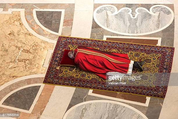 Pope Francis lies on the floor during the Good Friday Mass in St Peter's Basilica on March 25 2016 in Vatican City Vatican On Good Friday Pope...