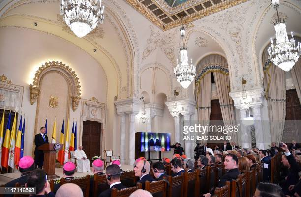 Pope Francis listens to Romania's President Klaus Iohannis giving a speech at the Presidential Palace in Bucharest on May 31 2019 Pope Francis is...