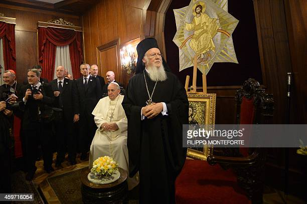 Pope Francis listens to the Ecumenical Patriarch Bartholomew I of Constantinople during a meeting at the St George church the principal Greek...