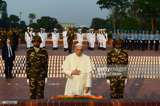 TOPSHOT Pope Francis looks on after laying a floral wreath at the National Martyrs' memorial of Bangladesh in Savar some 30 km from Dhaka on November...
