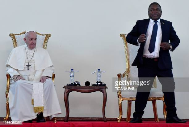 Pope Francis looks on as Mozambique President Filipe Nyusi stand up to deliver a speech during the meeting with the authorities, the civil society...