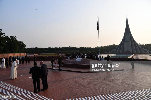 Pope Francis looks on at a wreathlaying ceremony at the National Martyrs' memorial of Bangladesh in Savar some 30 km from Dhaka on November 30 2017...