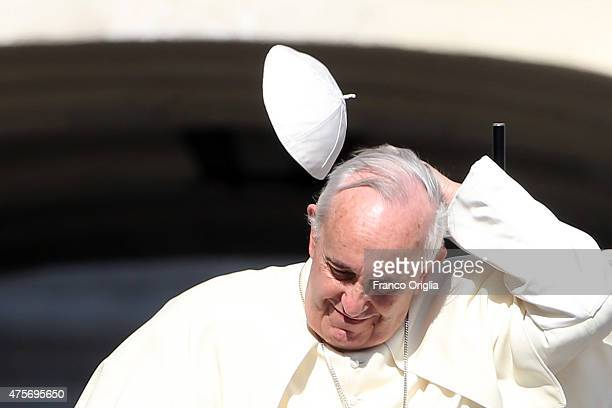 Pope Francis loses his biretta cap as he arrives in St Peter's square for his weekly audience on June 3 2015 in Vatican City Vatican Speaking during...
