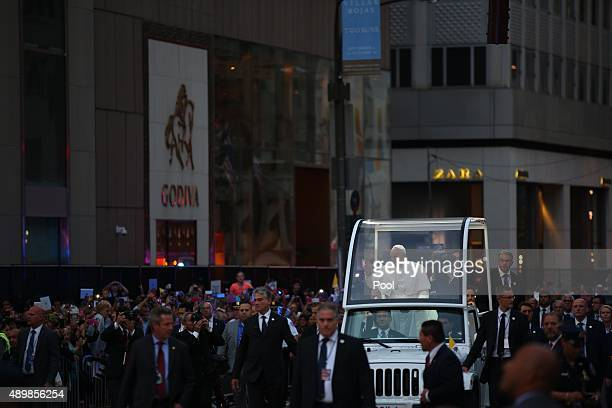 Pope Francis makes his way up Fifth Avenue toward St Patrick's Cathedral in the popemobile September 24 2015 in New York City Maryland The pope is on...