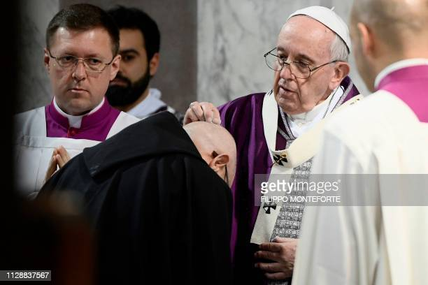 Pope Francis marks the sign of the cross with ashes on a monk's head during the Ash Wednesday mass which opens Lent the fortyday period of abstinence...