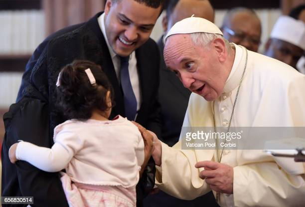 Pope Francis Meets a child as President of Cameroon Paul Biya and wife Chantal visit him on March 23 2017 in Vatican City Vatican