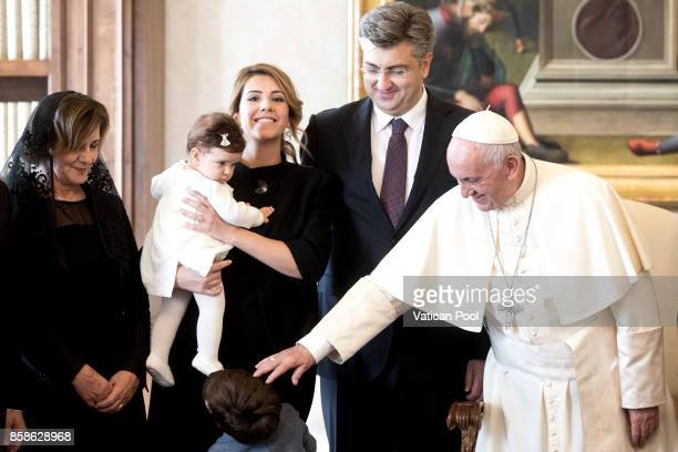 Pope Francis meets Croatia's Prime Minister Andrej Plenkovic and his family during an audience at the Apostolic Palace on October 7 2017 in Vatican...