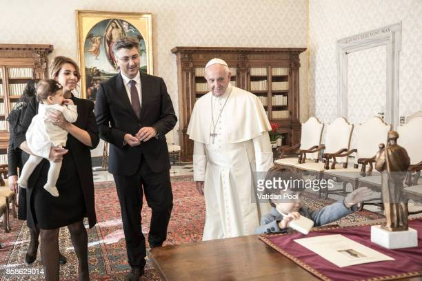 Pope Francis meets Croatia's Prime Minister Andrej Plenkovic his family and his delegation during an audience at the Apostolic Palace on October 7...