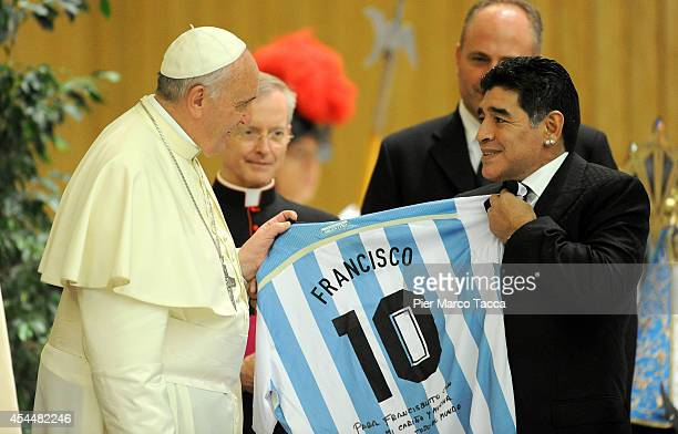 Pope Francis meets Diego Maradona during an audience with the players of the 'Partita Interreligiosa Della Pace' at Paul VI Hall before the...