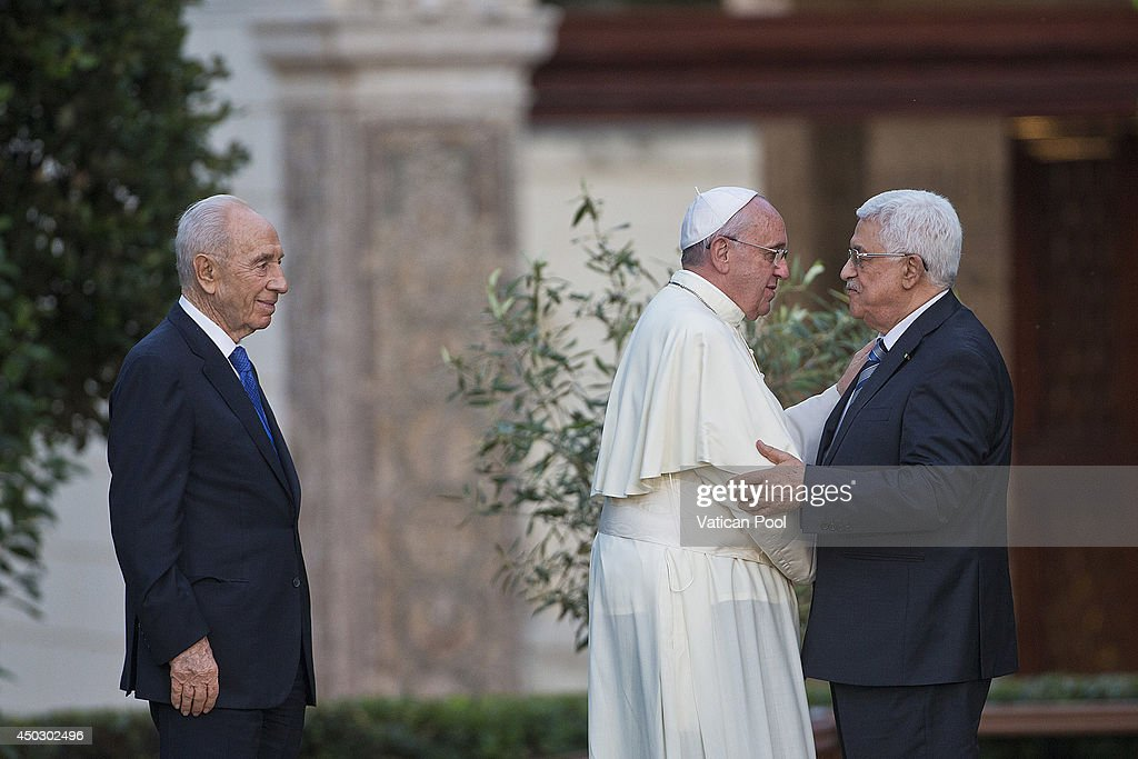 Pope Francis (C) meets Israeli President Shimon Peres (L) and Palestinian President Mahmoud Abbas for a peace invocation prayer at the Vatican Gardens on June 8, 2014 in Vatican City, Vatican. Pope Francis invited Israeli President Shimon Peres and Palestinian President Mahmoud Abbas to the encounter on May 25 during his visit to the Holy Land.