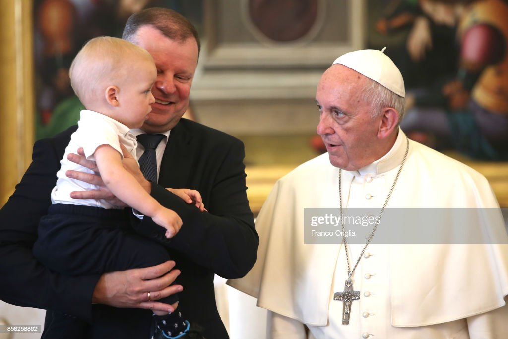 Pope Francis meets Lithuania Prime Minister Saulius Skvernelis and his son Tadas during an audience at the Apostolic Palace on October 6, 2017 in Vatican City, Vatican. peaking to the members of the Vatican's Pontifical Academy for Life at the start of their 2-day general assembly in Rome, Pope defended human dignity under attack from 'technocratic materialism'.