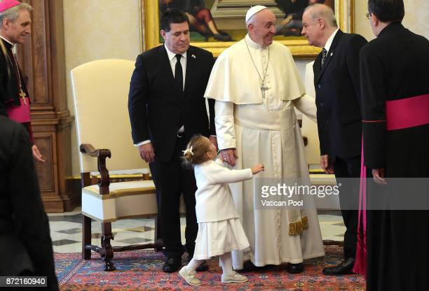 Pope Francis meets President of Paraguay Horacio Manuel Cartes Jara and his niece Sofia at the Apostolic Palace on November 9 2017 in Vatican City...