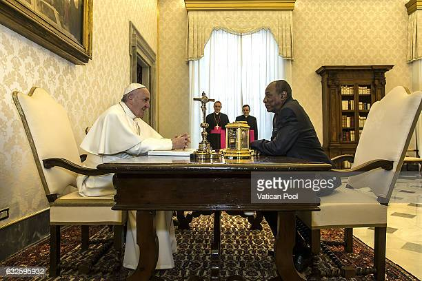 Pope Francis meets President of the Republic of Guinea Alpha Conde at the Apostolic Palace on January 16 2017 in Vatican City Vatican The colloquiums...