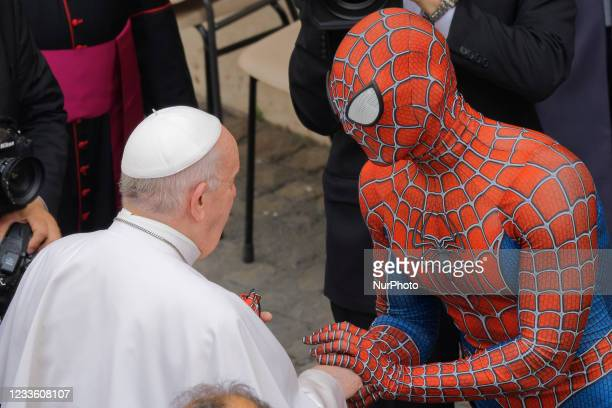 Pope Francis meets Spider-Man, who presents him with his mask, at the end of his weekly general audience with a limited number of faithful in the San...