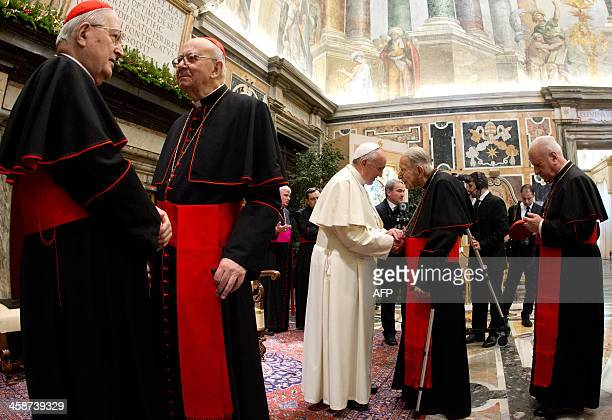 Pope Francis meets with cardinals at the end of the audience of the Curia the administrative apparatus of the Holy See for Christmas greetings in the...