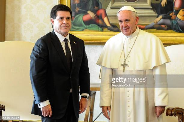 Pope Francis meets with President of Paraguay Horacio Cartes at his private library on November 25 2013 in Vatican City Vatican According to reports...