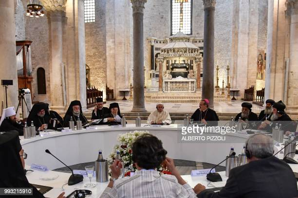 Pope Francis meets with religious leaders at the Pontifical Basilica of St Nicholas in Bari in the Apulia region in south Italy on July 7 2018 Pope...