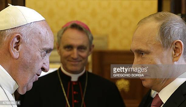 Pope Francis meets with Russian President Vladimir Putin on the occasion of a private audience at the Vatican, on June 10, 2015. AFP PHOTO POOL /...