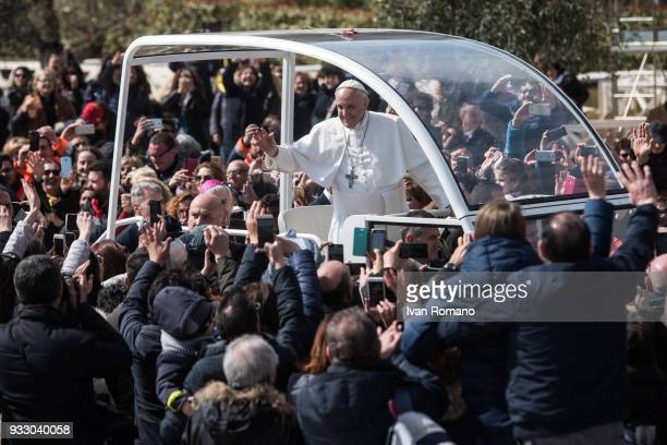 Pope Francis on the Popemobile greets the faithful on the Church Square of the Sanctuary of San Pio of Pietrelcina on March 17 2018 in San Giovanni...