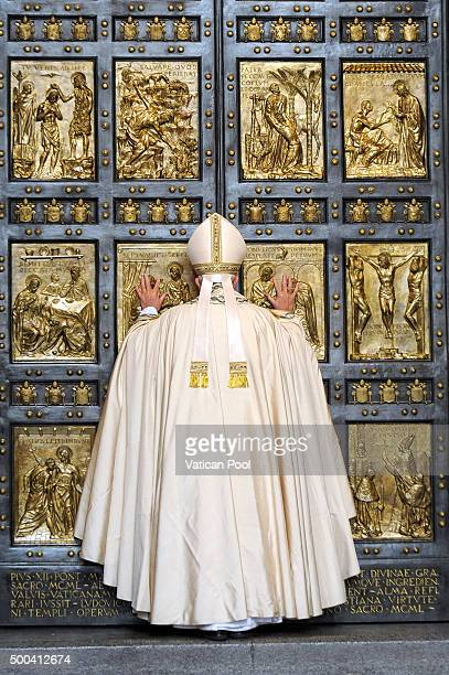Pope Francis opens the Holy Door of St Peter's Basilica on December 8 2015 in Vatican City Vatican During the solemnity of the Immaculate Conception...