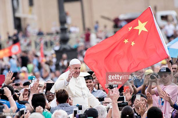 Pope Francis passes by a Chinese flag as he arrives for his weekly general audience in St Peter's Square at the Vatican Wednesday June 15 2016