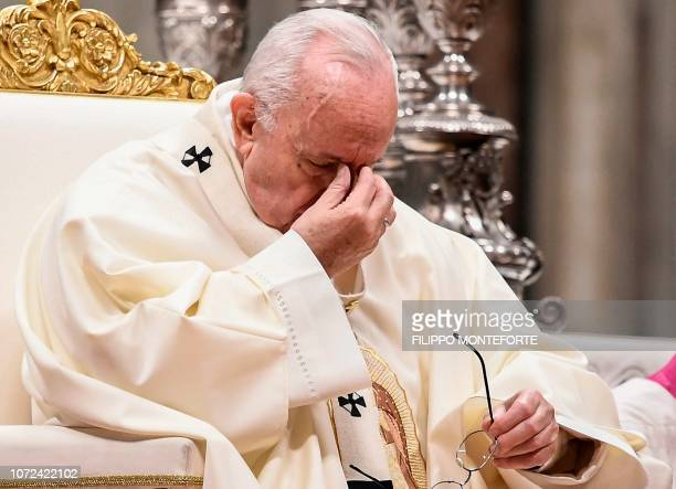 Pope Francis pauses as he celebrates a mass for the Virgin of Guadalupe in St Peters Basilica on December 12 2018 at the Vatican / ALTERNATIVE CROP