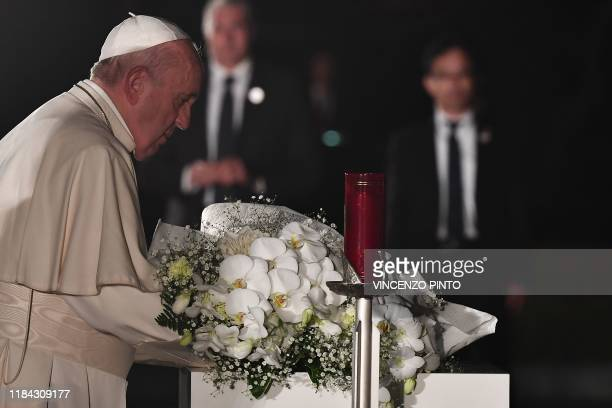 Pope Francis pays his respects in front of the cenotaph in memory of those killed in the 1945 atomic bombing during an event held at the Peace...
