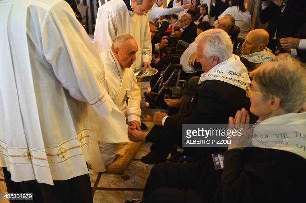 Pope Francis performs the traditional Washing of the feet during a visit at a center for disabled people as part of Holy Thursday as part of the Holy...