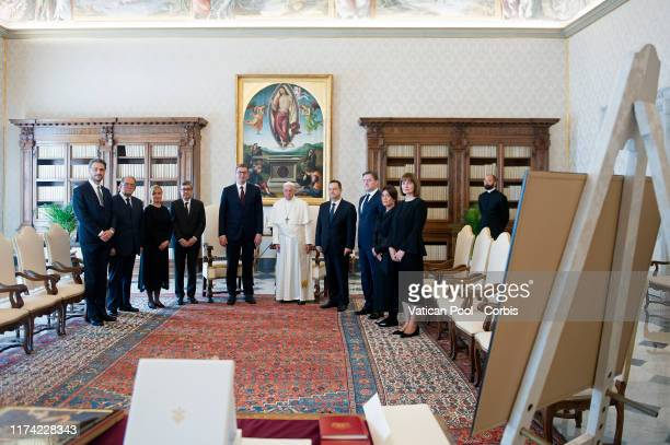 Pope Francis poses for a family photo with President Of Serbia Aleksandar Vucic and his delegation during a meeting at The Vatican on September 12,...