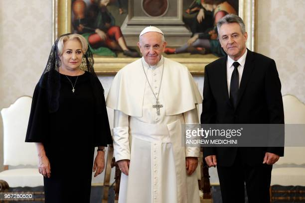 Pope Francis poses for a photo with Romania's Prime Minister Viorica Dancila and her husband Cristinel Dancila during a private audience in the...