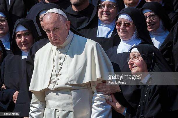 S SQUARE VATICAN CITY VATICAN Pope Francis poses for a photo with some nuns at the end of his Weekly General Audience in St Peter's Square Pope...