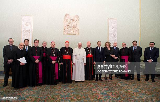 Pope Francis poses for a picture with Expo 2015 delegation President Diana Bracco flanked by cardinal Gianfranco Ravasi and Angelo Scola during a...