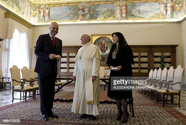 Pope Francis poses for photographers with Prime Minister of Albania, Edi Rama and his wife Linda, during a private audience at the Vatican, on April...