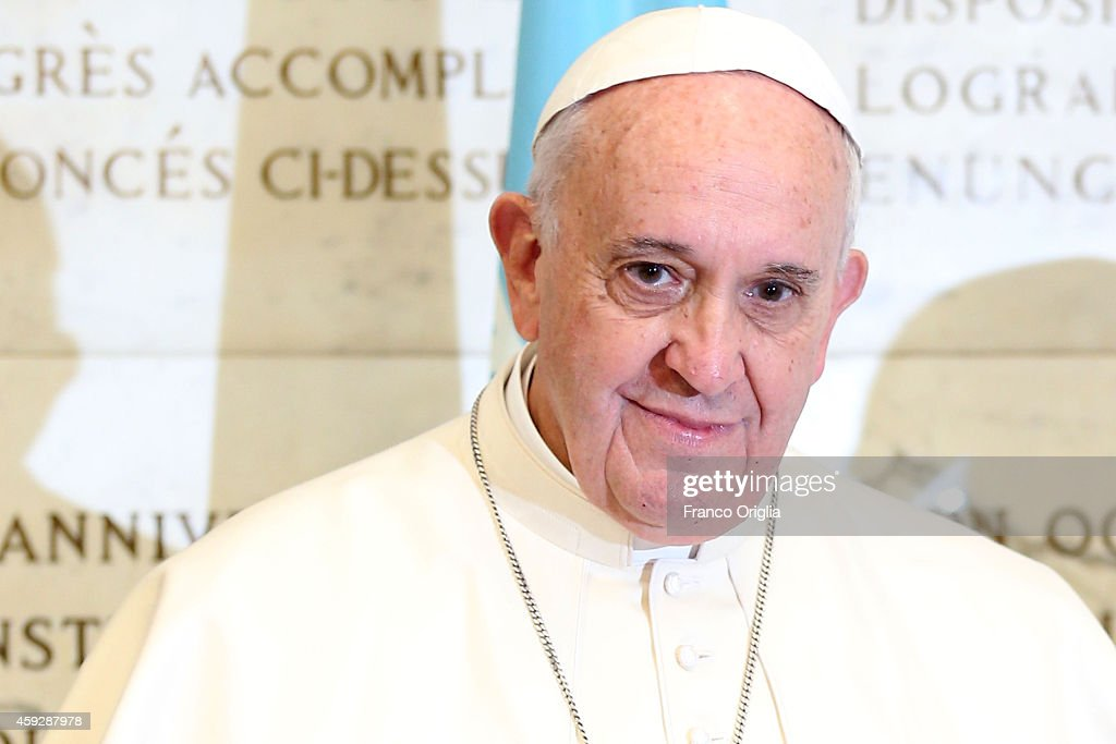 Pope Francis poses in front of the FAO constitution as he arrives at the Fao headquarter for Second International Conference on Nutrition on November 20, 2014 in Rome, Italy. In his address to participants the Holy Father spoke of waste and excessive consumption of food.