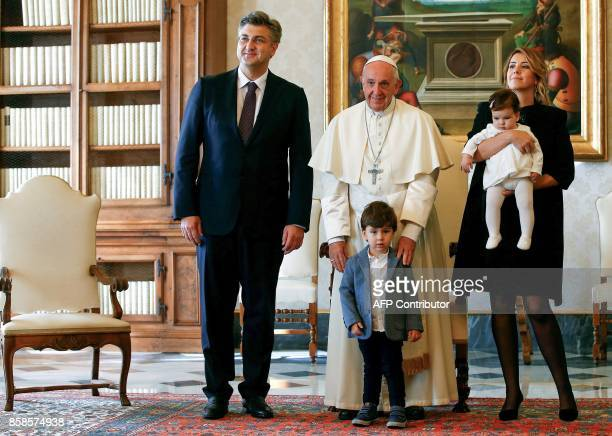 Pope Francis poses with Croatia's Prime Minister Andrej Plenkovic and his family during a private audience at the Vatican on October 7 2017 / AFP...