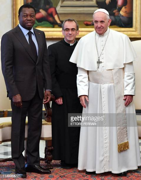 Pope Francis poses with Togo's President Faure Essozimna Gnassingbe Eyadema at the end of their private meeting at the Vatican on April 29 2019