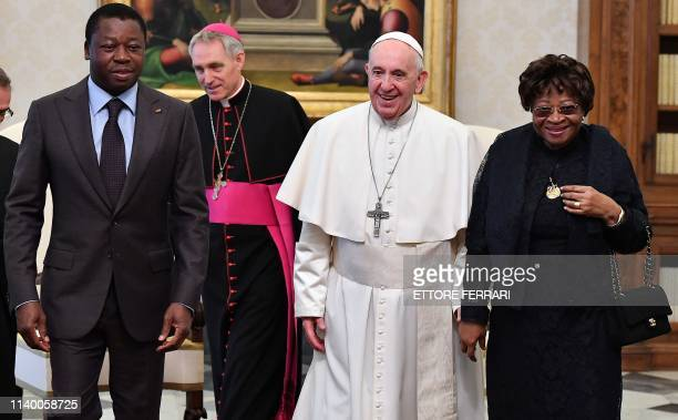 Pope Francis poses with Togo's President Faure Essozimna Gnassingbe Eyadema his mother Sabine Mensah and prefect of the papal household Georg...