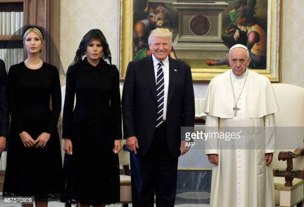 Pope Francis poses with US President Donald Trump , US First Lady Melania Trump and the daughter of US President Donald Trump Ivanka Trump at the end...
