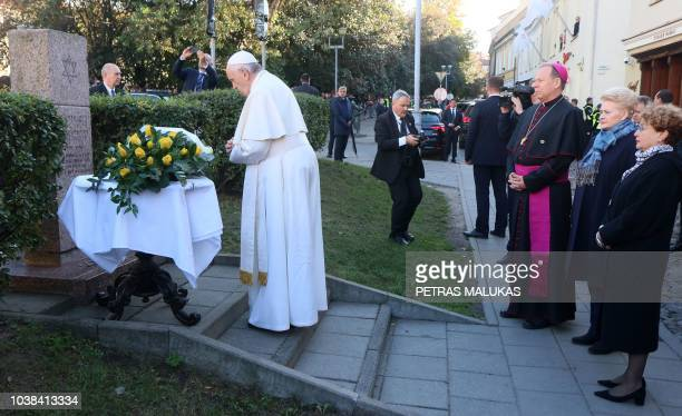 Pope Francis prays at the memorial to the Victims of the Ghetto in Vilnius at the Rudniky Square in Vilnius Lithuania on September 23 accompanied by...