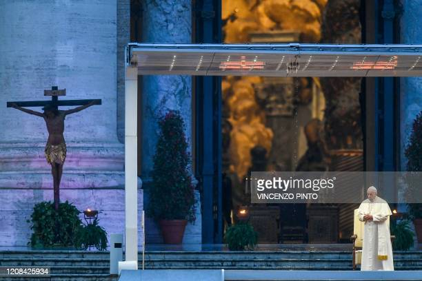 Pope Francis prays by a miraculous crucifix that in 1552 was carried in a procession around Rome to stop the great plague that was brought from the...