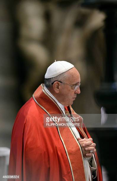 Pope Francis prays during the funeral ceremony for late Indian Cardinal D Simon Lourdusamy in Saint Peter's Basilica at the Vatican on June 5 2014...