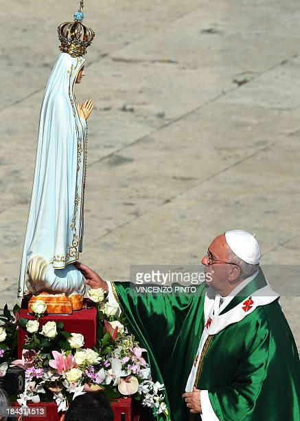 Pope Francis prays in front of the statue of Our Lady of Fatima in Saint Peter's square at the Vatican on October 13 at the end of the celebration of...