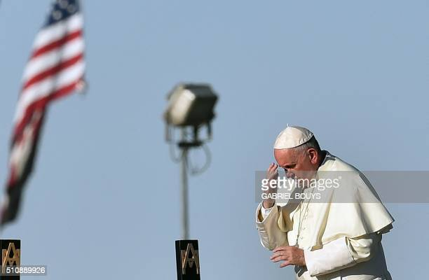 Pope Francis prays next to he US border before celebrating mass at the Ciudad Juarez fairgrounds on February 17 2016 Throngs gathered at Mexico's...